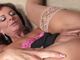Sexy mature in stockings & heels takes a facial