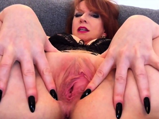 Busty adult redhead Red XXX stretches say no to pussy wide