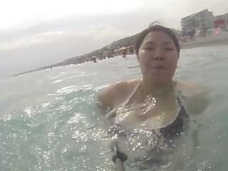 Asian wife big boobs swimming