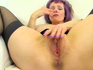 Busty and British milf Lulu Lush rubs her juicy put the touch on