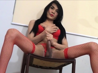Amateur Asian ladyboy in red undergarments masturbates her cock