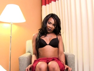 Transsexual black beauty plays with her bushwa
