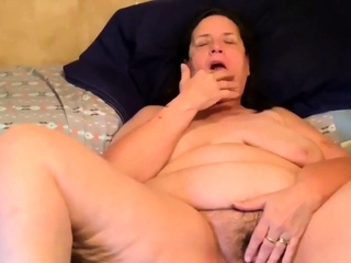 fucking my old hairy pussy with a dildo