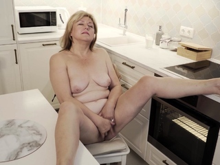 Jane Fox heads into the scullery to effect some cooking. The