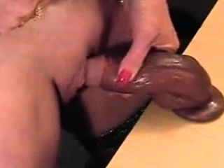 Hot gilf rubbing her big clit with slimy dick